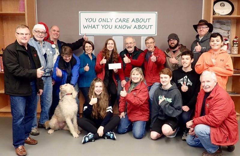 Miranda presenting a cheque to Mossom Creek volunteers